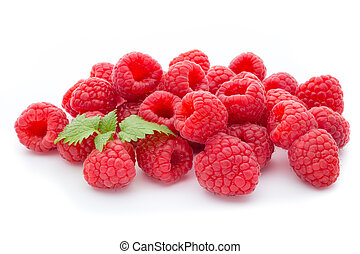 Ripe raspberry with leaf isolated on the white background.