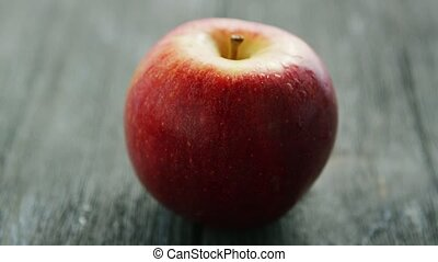 Ripe red apple on wooden desk - Closeup shot of delicious...