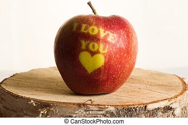 "red apple with the words ""I love you"""