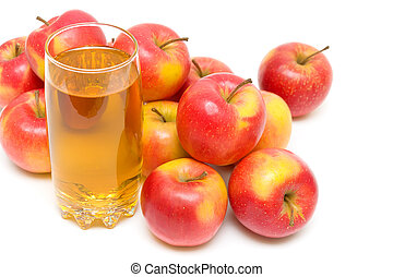 ripe red apples and glass with juice close up on a white background. horizontal photo.