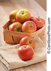 Ripe red apples on a wooden backgrounds