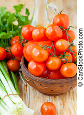 ripe red cherry tomatoes in a bowl