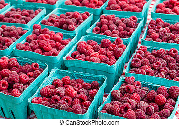 Ripe red raspberries at the market