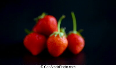 ripe red strawberry on a black background
