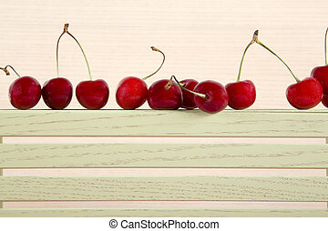 Ripe red sweet cherry on a plywood shelf
