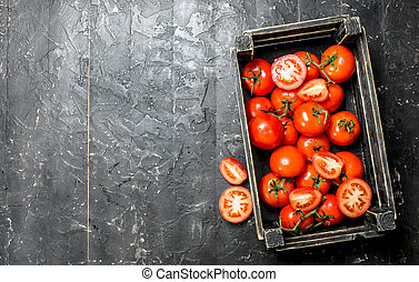 Ripe red tomatoes in a box.