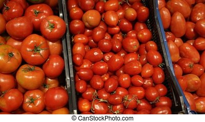 Ripe red tomatoes in boxes at supermarket - Fresh tomatoes ...