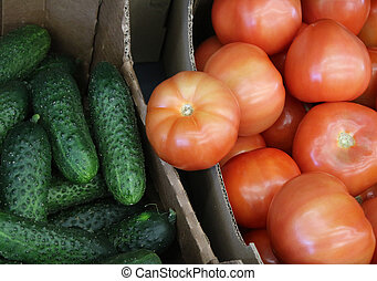 Ripe red Tomatoes in the store are in cardboard boxes, next to t