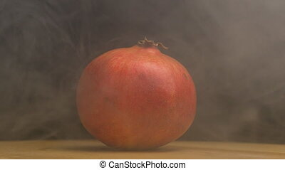 Ripe rotating pomegranate fruit from which evaporation and...
