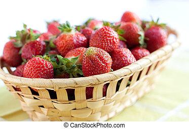 Ripe strawberries in a wooden basket