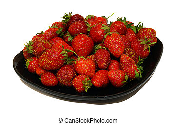 Ripe strawberries on a plate isolated on white background