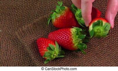Ripe strawberries on jute sackcloth
