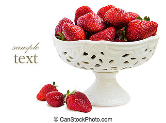 Ripe strawberries. - Ripe strawberries in a vase on a white...