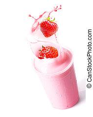Ripe strawberries splashing into fruit smoothie