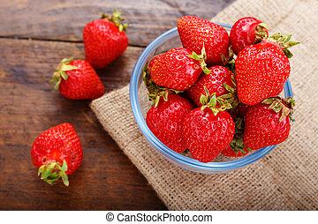 Ripe strawberry on burlap