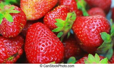 ripe strawberry rotates on a white background.