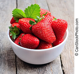 Ripe strawberry with leaves