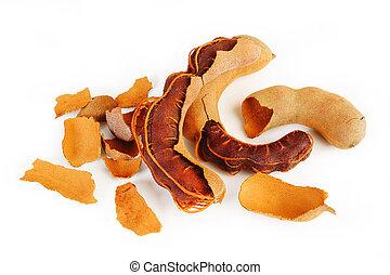 Ripe tamarind fruit on white