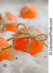 Ripe tangerines in snow