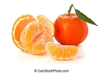 Ripe tangerines with green leaf - Ripe tangerines segments...