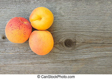 Ripe Tasty Apricots on the Old Wooden Table