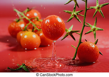 ripe tomato falling into water