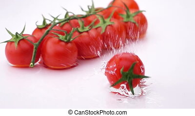 Ripe Tomato Falls on the Table.