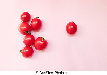 Ripe tomato on pink background. Creative concept. Square format. Top view.