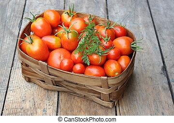 Ripe tomatoes in basket
