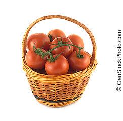 Ripe tomatoes in wicker basket