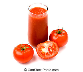 Ripe tomatoes near by glass of tomato juice
