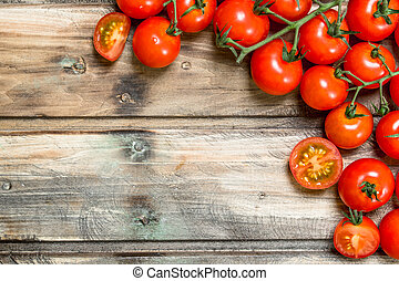 Ripe tomatoes on a branch.