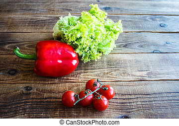 ripe tomatoes on a branch with pepper