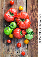 Ripe tomatoes on old wooden table