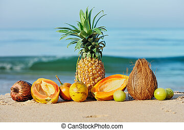 Ripe tropical fruit - Exotic tropical fruit on the sandy...