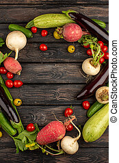 ripe vegetables fresh vitamine riched like red cherry tomatoes radish cucumber and others on a wooden floor