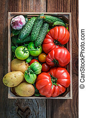 Ripe vegetables in wooden box