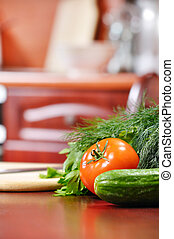 ripe vegetables is liying on table in kitchen