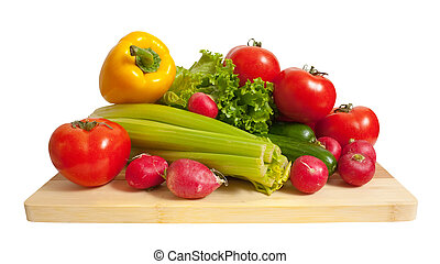 Ripe vegetables on wooden cutting board over white ...