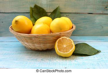 Ripe yellow lemons in a basket