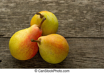 Pears on wooden background