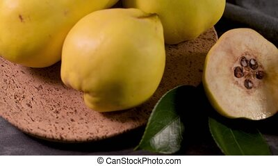 Ripe yellow quinces or queen apple fruits and sliced quince...