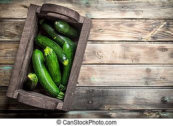 Ripe zucchini in the box.
