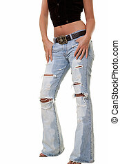 Ripped jeans - Legs of a woman wearing ripped faded jeans...