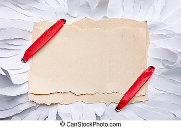 ripped piece of paper with red ribbon.