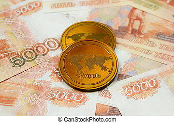 Ripple coin on 5000 Russian rubles banknotes close up. Crypto XRP Coin.