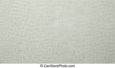 Ripple on water surface splash drops. White background. Slow...