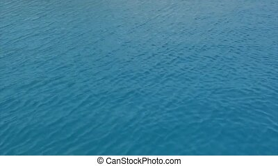 Ripples on the sea surface - Ripples on the blue sea surface