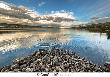 Rippling in serene water - Rippling in the serene water of...