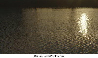 Rippling Water and Sun Reflection - Steady, exterior, medium...